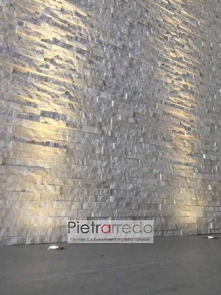 quarzite bianca brillantinata con faretti muro soggiorno