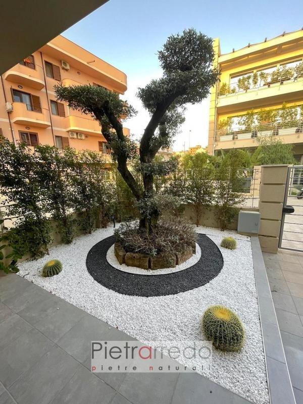 aiuola elegante arredo giardino stone ghiaietto neo bianco sotto ulivo pietrarredo milano